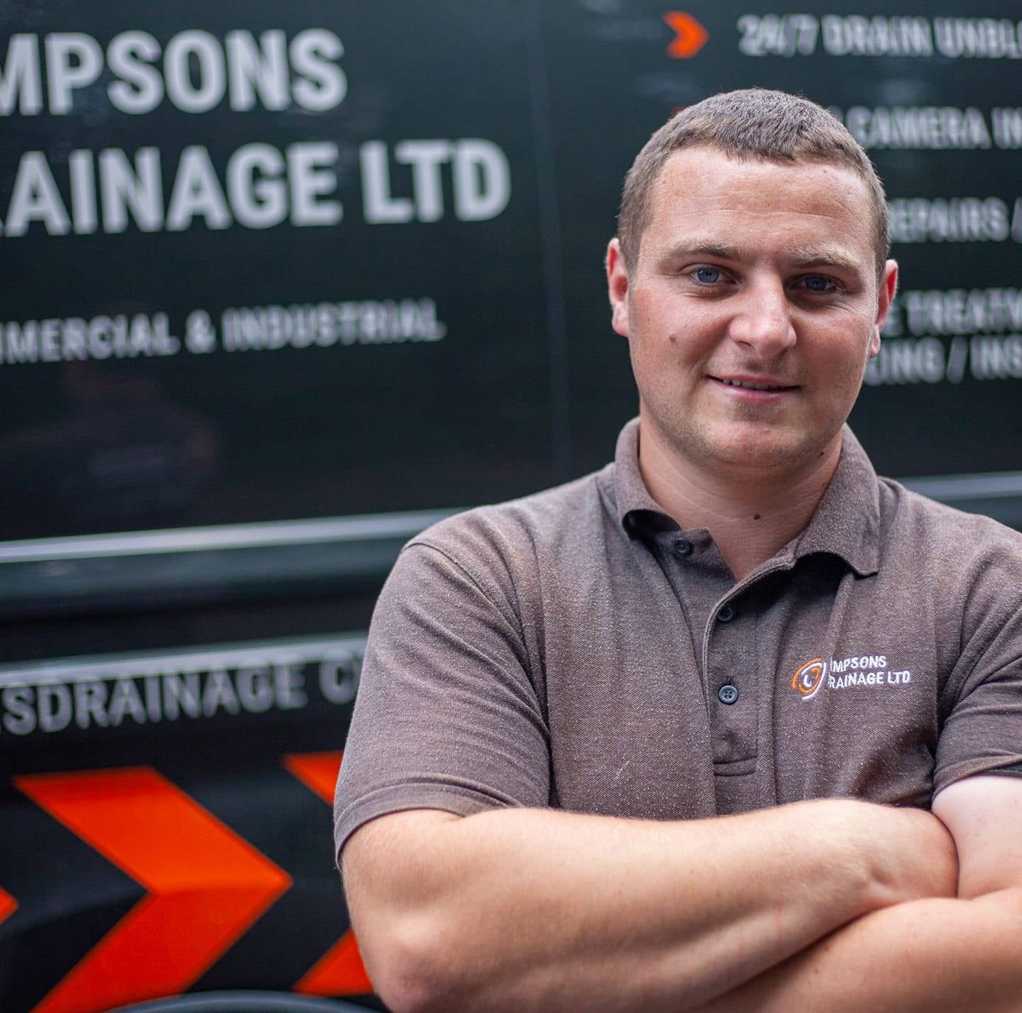 Person in front of company van. About page. Simpsons Drainage, Drain clearance, drain unblocking, septic tank services, septic tank emptying, drain camera surveys, drain repairs, drain lining, new drains in Warminster, Frome, Trowbridge.