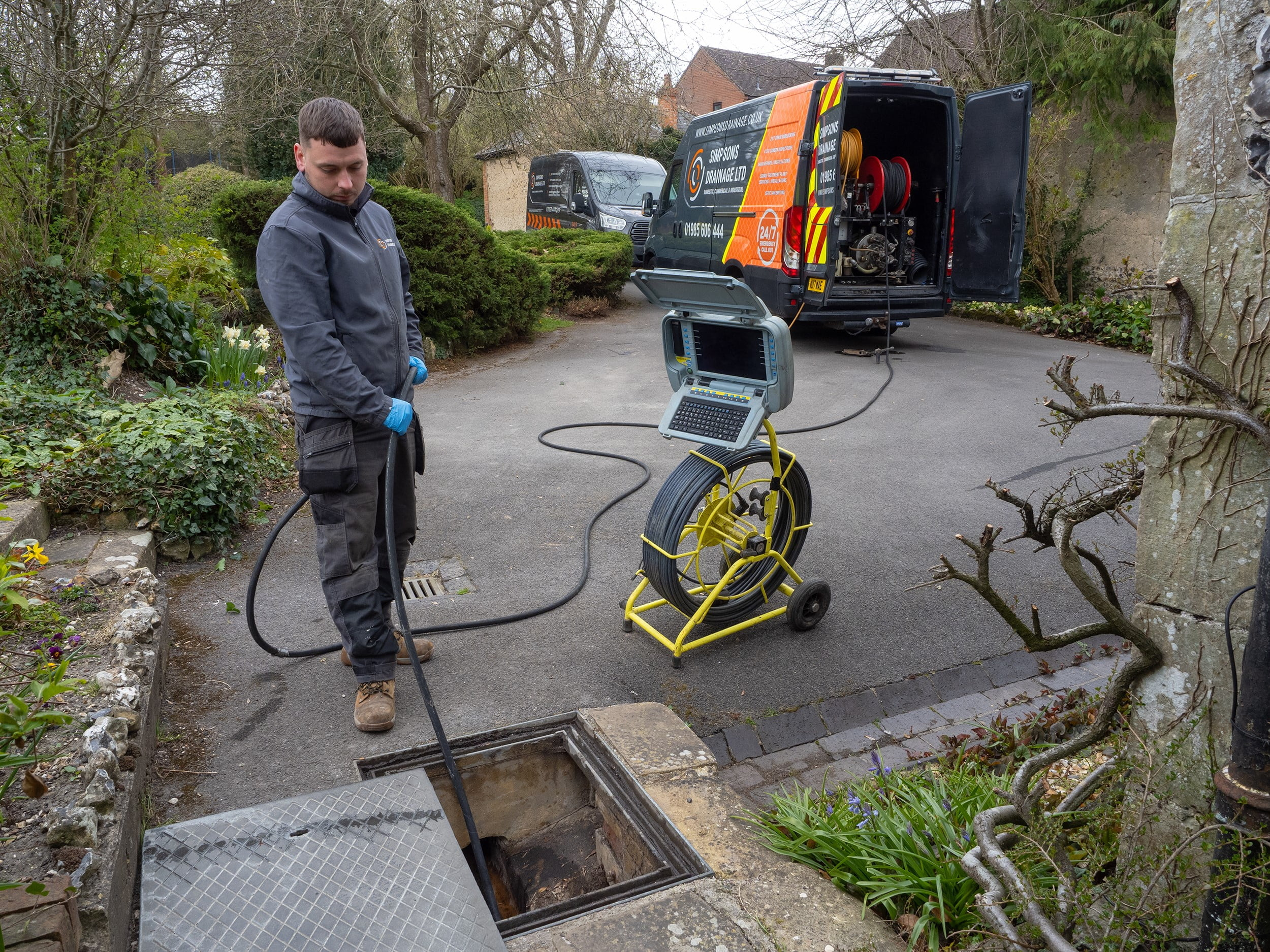 Person carrying out drain survey. Drains service page. Simpsons Drainage, Drain clearance, drain unblocking, septic tank services, septic tank emptying, drain camera surveys, drain repairs, drain lining, new drains in Warminster, Frome, Trowbridge.